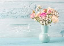 Pink roses. In a bluewooden background royalty free stock photos