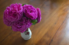 Pink roses bouquet. Against a wooden background Stock Image