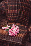 Pink roses bouquet on chair for date Stock Photo