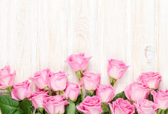 Pink roses bouquet over wooden table Royalty Free Stock Photo