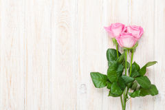 Pink roses bouquet over wooden table Royalty Free Stock Photos