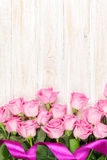 Pink roses bouquet over wooden table Stock Photos