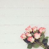 Pink roses bouquet on white tablecloth with copy space. Toned, soft focus. Royalty Free Stock Photography