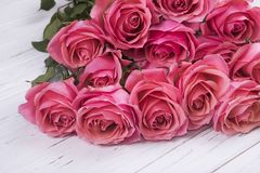 Pink roses bouquet on white wooden background. Royalty Free Stock Photo