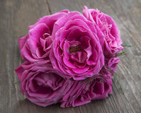 Pink roses bouquet on wooden background Stock Photos