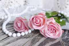 Pink roses bouquet on a wooden background. Mother`s Day background. Holiday and seasonal design. Greeting card and copy space Stock Images