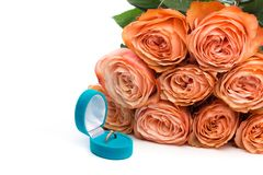 Pink roses and box holding wedding ring isolated on white background - Image royalty free stock images