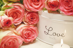 Pink roses and candle light Royalty Free Stock Photos