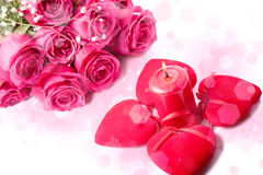 Pink roses, candle and red hearts Royalty Free Stock Images