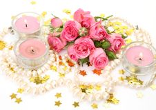 Pink roses and candles Royalty Free Stock Photos