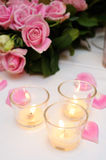 Pink roses and candles Royalty Free Stock Images