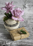 Pink roses in a ceramic vase with Greek ornament, homemade gift box Royalty Free Stock Photo