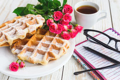 Pink roses, coffee, notebook, pensil and Belgium waffles Royalty Free Stock Images