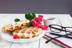 Pink roses, coffee, notebook, pensil and Belgium waffles Royalty Free Stock Photography