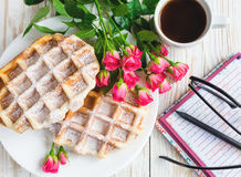 Pink roses, coffee, notebook, pensil and Belgium waffles Royalty Free Stock Photos