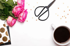 Pink roses, coffee and other things on white background Royalty Free Stock Images