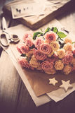 Pink roses, craft paper Stock Photography