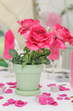 Pink roses decorate table. Pink roses decorate a table at wedding reception Stock Images