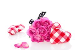 Pink roses and decorative hearts Royalty Free Stock Photos