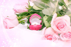 Pink roses with diamond ring Stock Photos