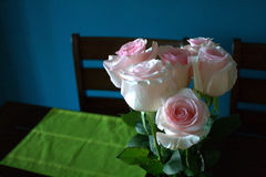 Pink roses on a dining table Royalty Free Stock Photo