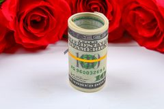 Pink roses with dollar bills instead of a gift. Template for March 8, Mother's Day, Valentine's Day. Pink roses with dollar bills instead of a gift. Template Royalty Free Stock Photo