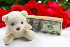 Pink roses with dollar bills instead of a gift. Template for March 8, Mother's Day, Valentine's Day. Pink roses with dollar bills instead of a gift. Template Royalty Free Stock Image