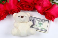 Pink roses with dollar bills instead of a gift. Template for March 8, Mother's Day, Valentine's Day. Pink roses with dollar bills instead of a gift. Template Stock Photo