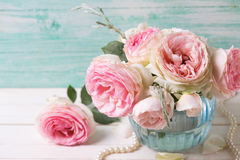 Pink roses flowers  in blue vase Royalty Free Stock Image