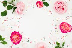 Pink roses flowers with candy and marshmallow isolated on white background. Flat lay, Top view. Floral texture. Summer composition stock images
