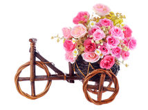 Pink roses flowers in a decorative wooden bicycle Royalty Free Stock Images