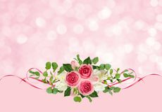 Pink roses, freesia flowers, eucalyptus leaves and satin ribbons. On holiday background royalty free stock image