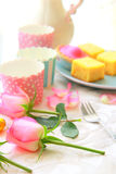 Pink roses and fresh cakes Stock Photo