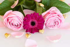 Pink roses and gerbera with golden hearts and leaves Stock Photography