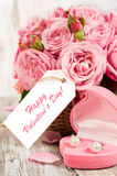 Pink roses and gift in a basket Stock Images