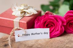 Pink roses and gift box with Happy Mother`s day tag card. Pink roses and red gift box with Happy Mother`s day tag card, gift box for giving in Mother`s day Stock Photography