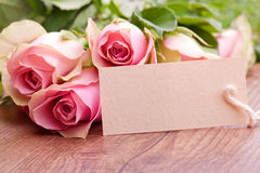 Pink roses and gift card Royalty Free Stock Photo