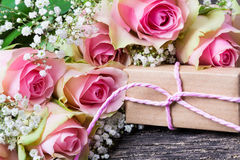 Pink roses and gift Royalty Free Stock Photo