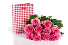 Pink roses and a giftbag Royalty Free Stock Images