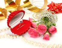 Pink roses and gold ring Stock Images