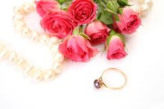 Pink roses and gold ring Stock Photography