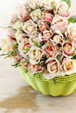 Pink roses in green wicker basket Royalty Free Stock Images