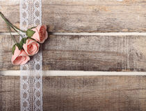 Pink roses greeting card. Pink roses on wooden background - greeting card or invitation Royalty Free Stock Image