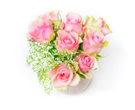 Pink roses and gypsophila in a vase Stock Photos