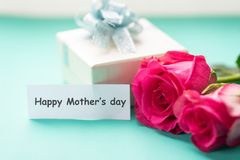 Pink roses with Happy Mother`s day tag card. Pink roses and gift box with Happy Mother`s day tag card Royalty Free Stock Photos