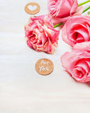 Pink roses with heart and message  for you on white wooden background, close up Royalty Free Stock Photo