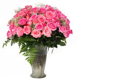 Pink Roses. Huge Bouquet in Glass Vase isolated on white. Background with space for the text Royalty Free Stock Photo