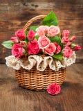 Pink Roses In A Vintage Basket Royalty Free Stock Image
