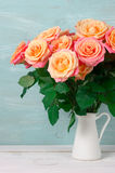 Pink roses in jug Stock Image
