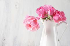 Pink roses in jug Stock Images